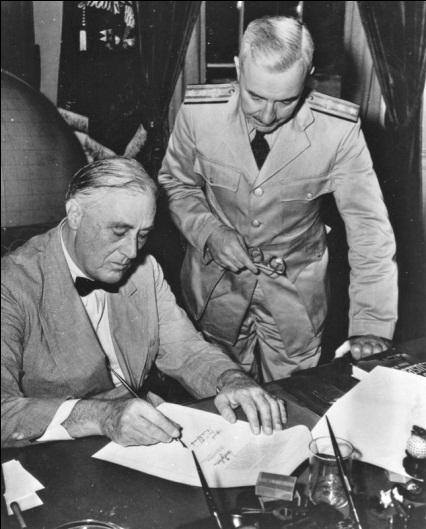 Surgeon General Thomas Parran witnessing President Franklin Delano Roosevelt signing the Bolton Act into law.