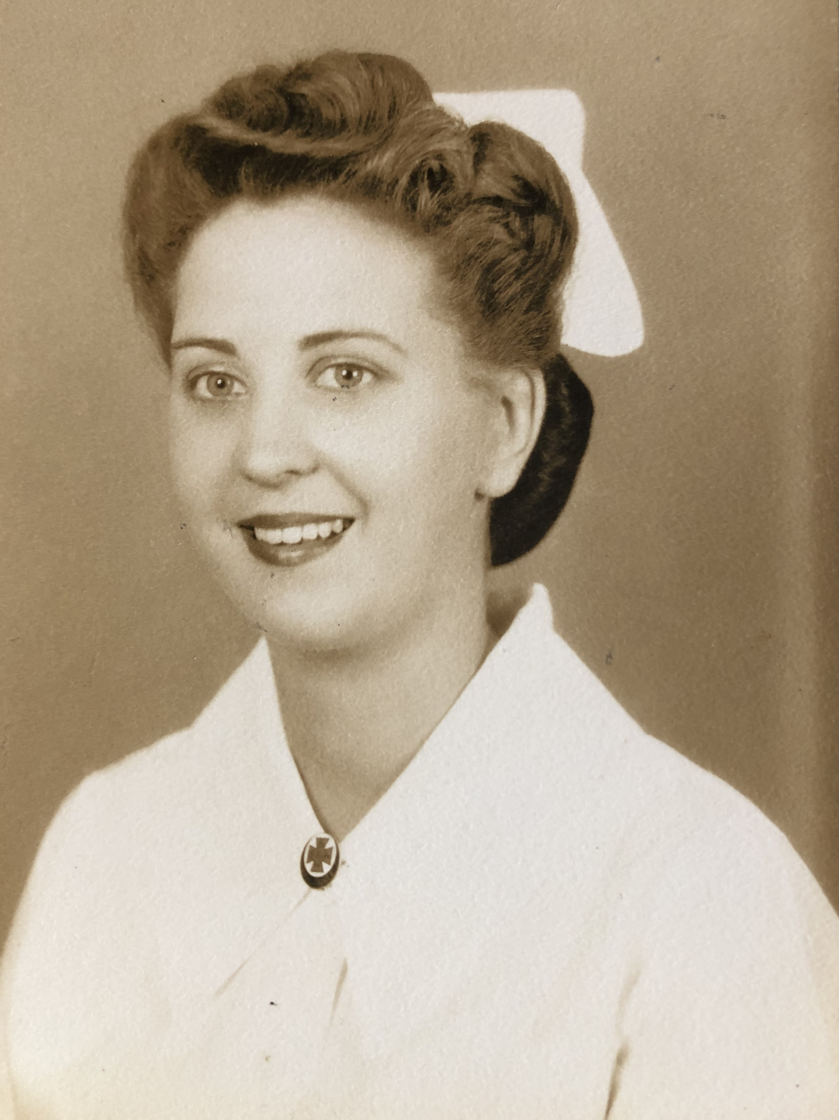 Beverly in hospital whites
